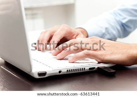 Writing on a white laptot