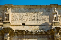 Writing on Arch of Constantine, triumphal arch in Rome, Italy