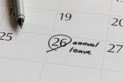writing on calendar annual leave