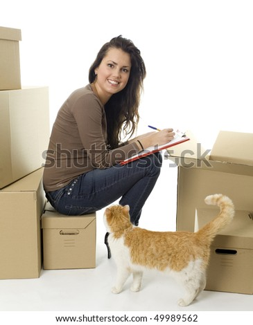 writing on clipboard smiling woman from boxes and cat