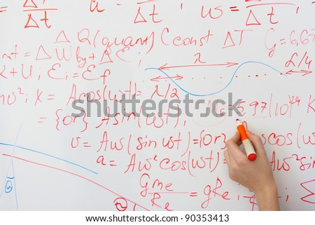 writing on the whiteboard formulas, closeup