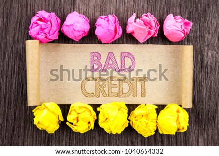 Writing text  Bad Credit. Concept meaning Poor Bank Rating Score For Loan Finance written sticky note paper with folded paper yellow and pink the wooden background.
