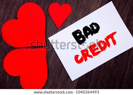 Writing text showing  Bad Credit. Concept meaning Poor Bank Rating Score For Loan Finance written on notobook paper note on  wooden background with Love Heart.