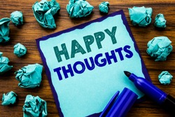 Writing text showing Happy Thoughts. Business concept for Happiness Thinking Good Written on sticky note paper, wooden background marker folded yellow paper meaning thinking