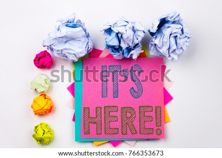 Writing text showing It's Here written on sticky note in office with screw paper balls. Business concept for advertisement on the isolated background. #766353673