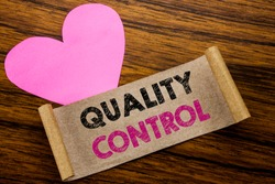 Writing text showing Quality Control. Business concept for Improvement Work written on sticky note paper, wooden background. With pink heart meaning love adoration.