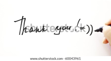 "Writing ""Thank you!"" with smile on the white"