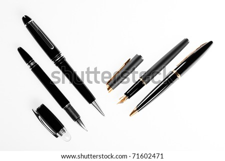 writing tools , cost pens isolated on white