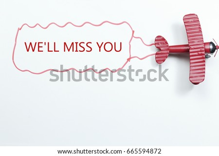 Shutterstock writing We'll Miss You red toy airplane with talk bubble on white background