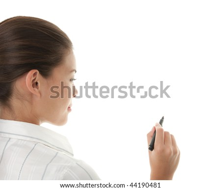 Writing with pen. Young beautiful businesswoman with pen writing on whiteboard. Focus on black marker. Lot's of copy space. Mixed race chinese / caucasian model isolated on seamless white background.