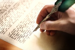Writing with quill pen last will and testament or concept for law, legal issues or author