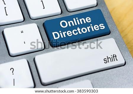 Written word Online Directories on blue keyboard button.