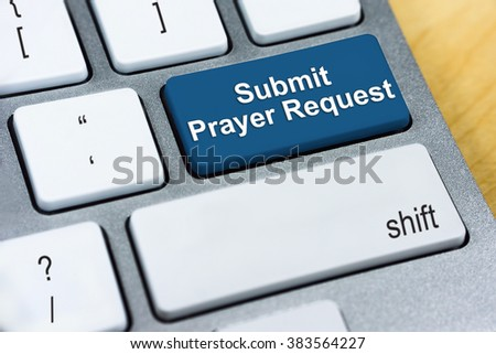 Written word Submit Prayer Request on blue keyboard button. Online Submission Concept Foto d'archivio ©