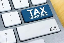 Written word Tax Deduction on blue keyboard button