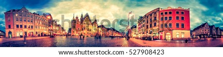 Wroclaw Market Square with Town Hall during sunset evening, Poland, Europe. Panoramic montage from 27 HDR Photos with post processing effects #527908423