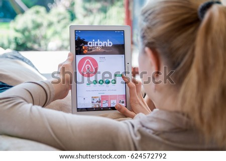 WROCLAW, POLAND- APRIL 10th, 2017: Woman is installing Airbnb application on Lenovo tablet. Airbnb is an online marketplace and hospitality service, enabling people to lease or rent short-term lodging