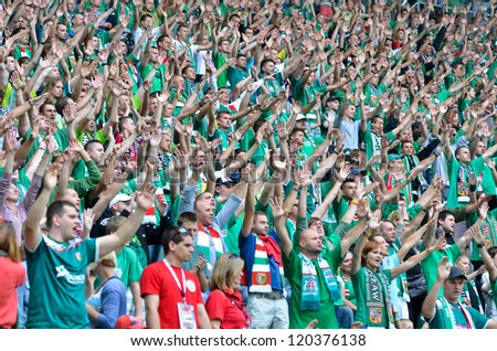 WROCLAW, POLAND - JULY 21: Semifinal Polish Masters tournament between WKS Slask Wroclaw and Benfica Lisbon 2:4, cheering fans of WKS Slask Wroclaw on July 21, 2012 in Wroclaw, Poland.