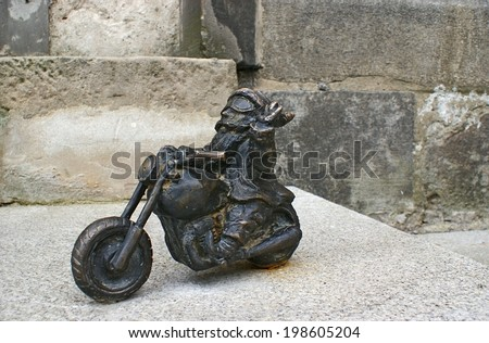WROCLAW, POLAND - JULY 5, 2010: The figurine of dwarf the biker located next to the St Mary Magdalene Church, rumored in honor of the abbot, who is the biker too, on July 5 in Wroclaw.