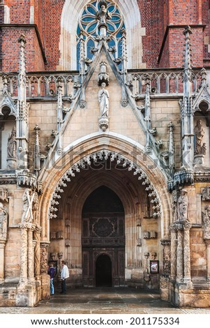 WROCLAW, POLAND - OCTOBER 7, 2009: Entrance to Cathedral of St. John the Baptist in Wroclaw, seat of the Roman Catholic Archdiocese of Wrocl?aw. It's Gothic church with neo-gothic additions. #201175334