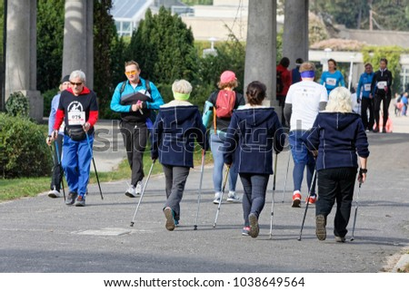 WROCLAW, POLAND - OCTOBER 15, 2017: People in fitness course nordic walking competition in the city park #1038649564