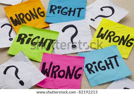 wrong or right dilemma or ethical question - handwriting on colorful sticky notes - stock photo