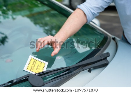 Wrong parking ticket fine placed on the car windshield