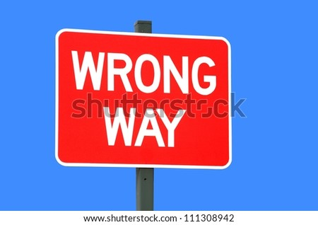 wrong way sign isolated against a blue background