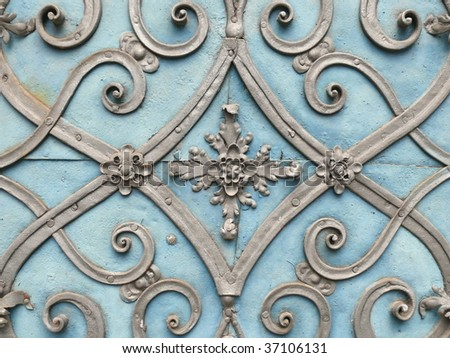 Wrought iron door decoration closeup. More of this motif in my port.