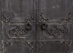wrought iron doors. with circular handle