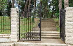 Wrought iron gate at the entrance to the city park in Tivat, Montenegro