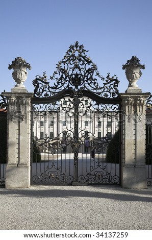 Wrought iron gate of old castle is closed.