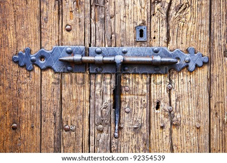 wrought iron lock old wooden door