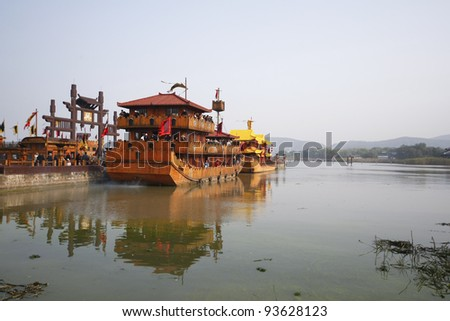 WUXI, CHINA - NOVEMBER 25: An ancient battle ship takes tourists for a cruise at the Tai Lake on Nov 25, 2011 in Wuxi, China. Ships like this took part in the war of the 3 kingdoms in 220AD to 280AD.