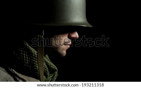 WW2 American Soldier With Face In Deep Shadow Stock fotó ©