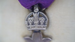 WW1 British Civilian MBE Medal and Box. Awarded in the 1919 New Year's Honours List for civilian service in the UK during the Great War. Macro close up on this amazing vintage medal