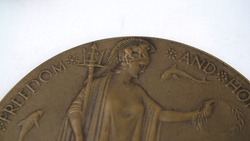 WW1 British Death Plaque also sometimes referred to as the 'dead man's penny'. These were sent, along with a certificate from the King, to the next of kin of service personnel who died in WW1