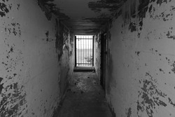 WW2 German bunker , Jersey, U.K. BW image of a scary gated corridor from 1945.