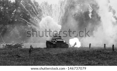 WW2 German Panzer 38 (t) light tank, and the explosion of a shell hit