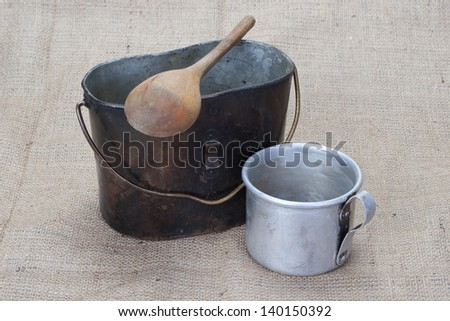 WW1 period Mess Kit, wooden spoon and aluminium mug - stock photo