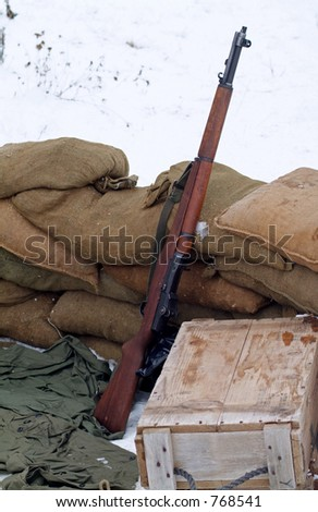 WWII rifle in a winter setting.