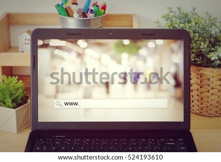 www. on search bar over blur store background on labtop screen, on line shopping ,business, E-commerce, technology and digital marketing
