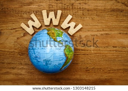 www - site  and globe map on wooden background. Empty copy space for inscription. #1303148215