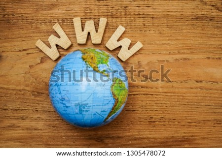 www - site  and globe map on wooden background. Empty copy space for inscription. #1305478072