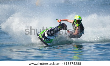 WYBOSTON, BEDFORDSHIRE, ENGLAND -  APRIL 09, 2017: Jet Ski competitor cornering at speed creating at lot of spray. #618875288