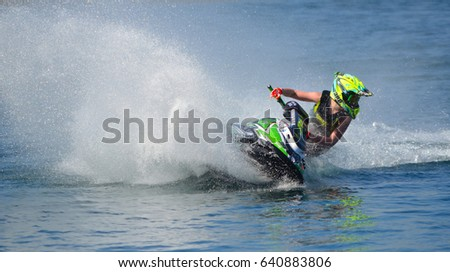 WYBOSTON, BEDFORDSHIRE, ENGLAND -  APRIL 09, 2017: Jet Ski competitor cornering at speed creating at lot of spray. #640883806