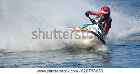 WYBOSTON, BEDFORDSHIRE, ENGLAND -  APRIL 09, 2017: Jet Ski cornering at speed creating at lot of spray. #626798630