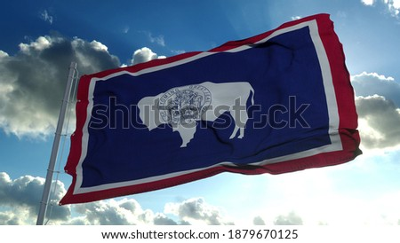 Wyoming flag on a flagpole waving in the wind, blue sky background. 3d rendering. ストックフォト ©