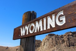 Wyoming on a wooden sign