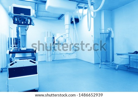 X-ray machine with control panel and scanning screen in modern clinics