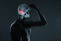 X-ray of a man's head. Medical examination of head injuries. Cerebral stroke. The back of the brain is highlighted by red colour. Others x-ray images in my portfolio.